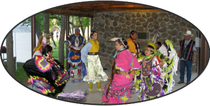 A group of Arapahos dance in traditional regalia