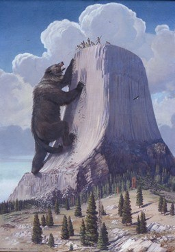 A giant bear climbing Devils Tower
