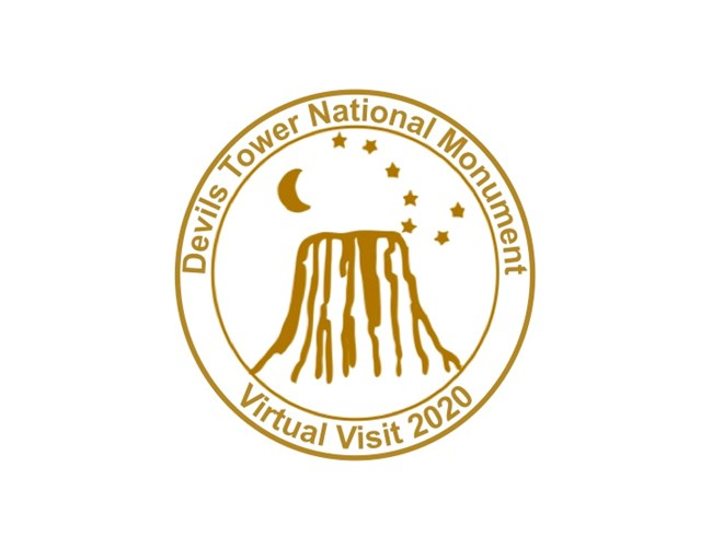 Gold stamp with the words Devils Tower National Monument Virtual Visit 2020 surrounding a line image of Devils Tower with the moon and stars.