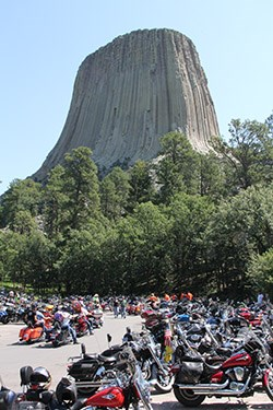 Motorcycles crowded into the parking area at the base of the Tower