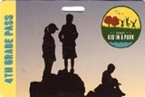 A park pass showing the silhouettes of kids standing on rocks