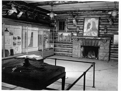 The inside of a log structure with various exhibits and artifacts