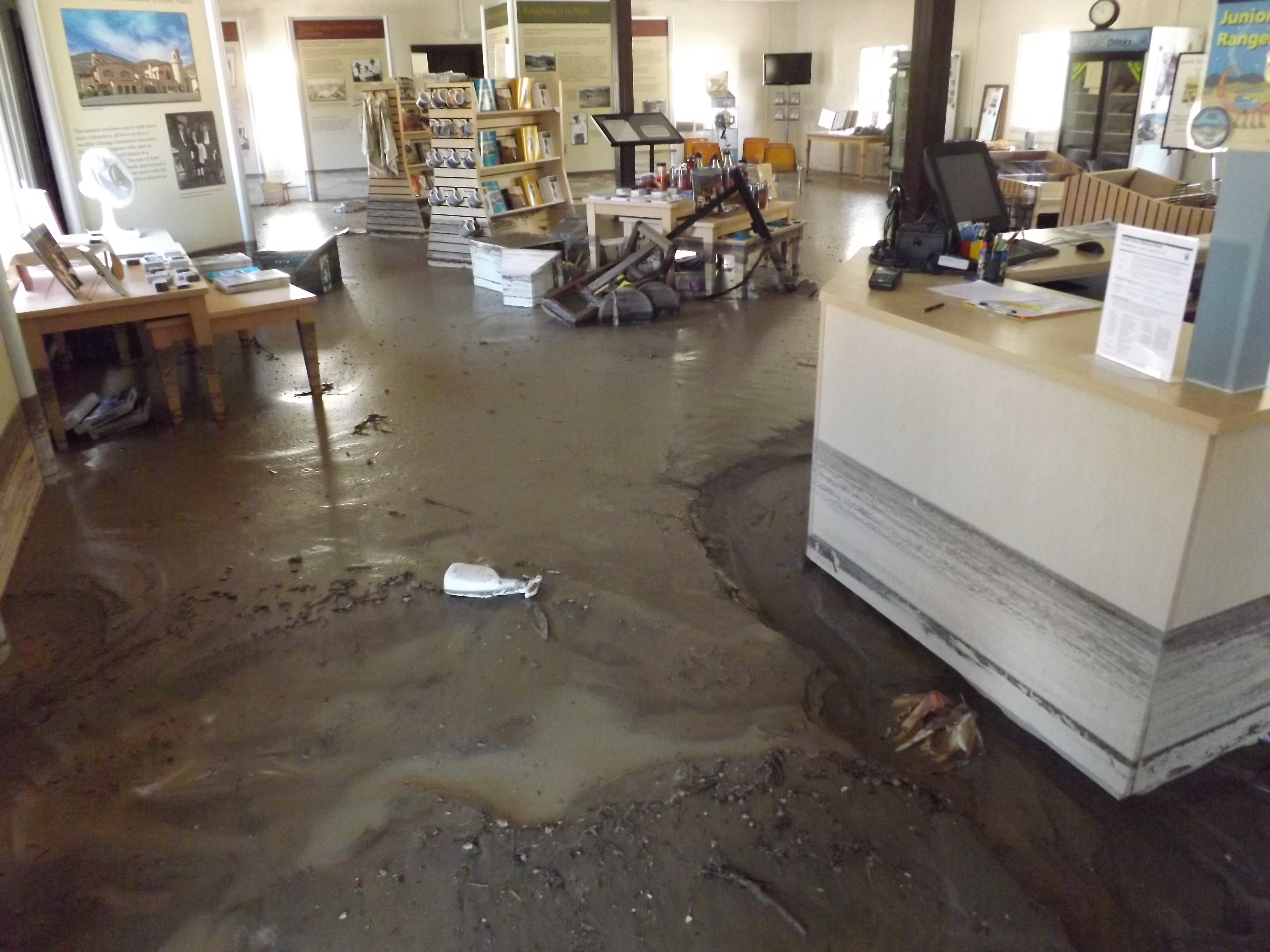 The main room of the visitor center, including the front desk and the gift store, with about one foot of mud covering the entire floor.