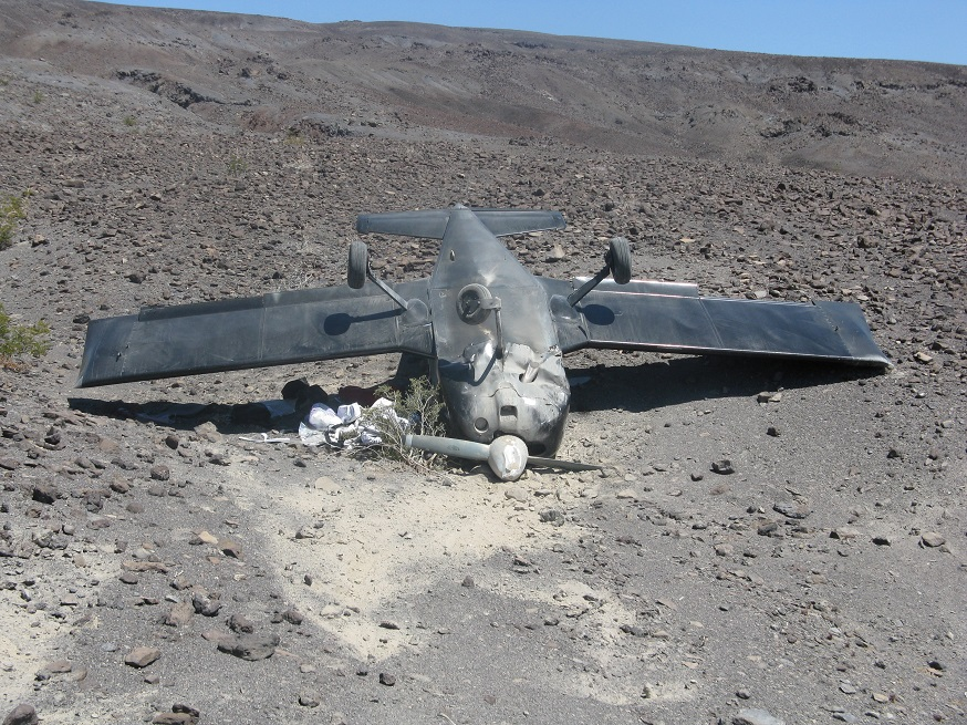 Small plane flipped onto its roof at remote Saline Valley airstrip.
