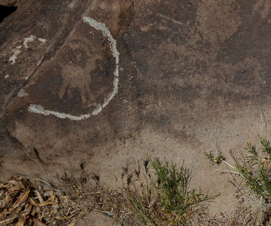 A vandal tried to remove this bighorn sheep petroglygh at a different archeological site in Death Valley National Park.