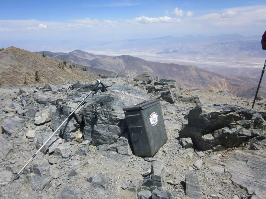 An old ammo can serves as a trail register on a high mountain peak.
