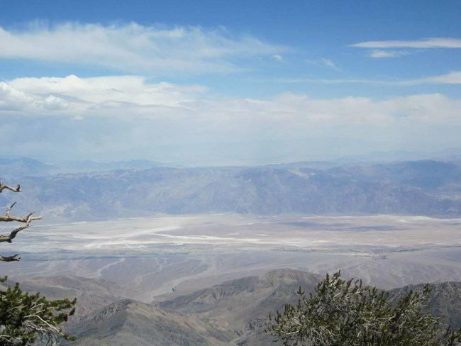 A view of salt flats and mountains from the highest point overlooking Death Valley.