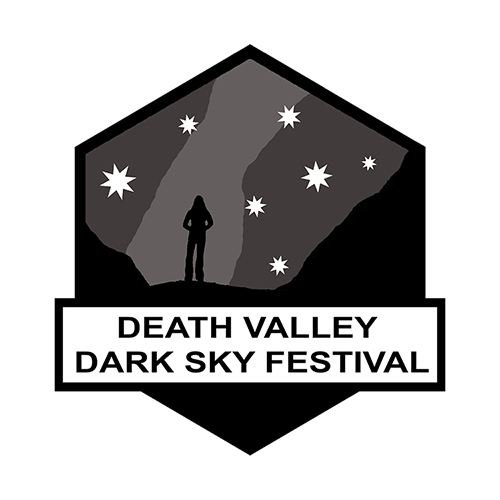 A logo of a woman's silhouette with the Milky Way in the background