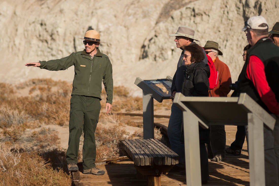Park Ranger points out feature to crowd of visitors on guided tour.