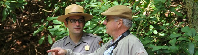 man talking to a park ranger