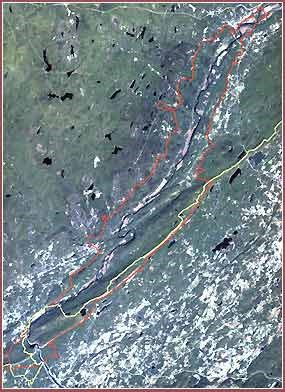 Satellite image of a river valley. Boundaries are overlaid on the image in red and yellow.