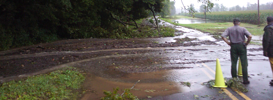 road covered with debris after flooding