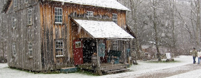 old house with snow falling