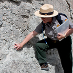 A ranger points out a fossil on the Fossil Discovery Trail