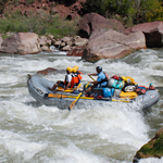 Rafters plunge into rapids on the Green River