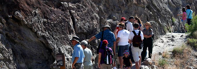 A ranger leads a group for a hike on the Fossil Discovery Trail