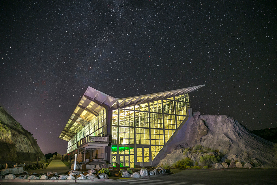 A starry sky fills the sky above the monument's Dinosaur Quarry Exhibit Hall.