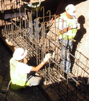 Workers install rebar at Quarry Exhibit Hall.