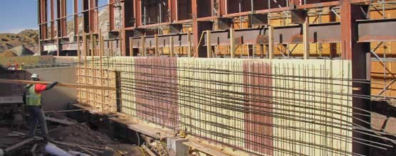 Rebar and forms for a concrete wall.