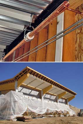 View of installed radiant heat piping (top) and lower half of building draped in plastic (bottom).