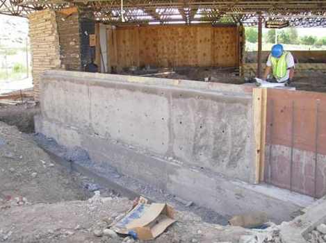 New concrete wall in what was the plaza at the temporary visitor center and is now a construction site.