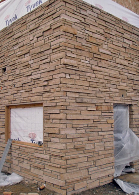 Photo of completed stonework in the exterior corner of the builiding.