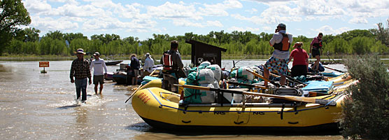 A rafting trip prepares to launch on Thursday, June 9, 2011 from Deerlodge Park on the Yampa River.