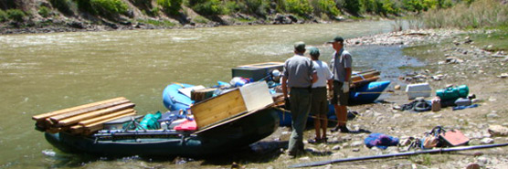 Rafts loaded with building materials to be removed from recommended wilderness.