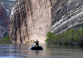 A rafter passes by Steamboat Rock