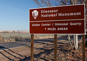 Dinosaur road sign