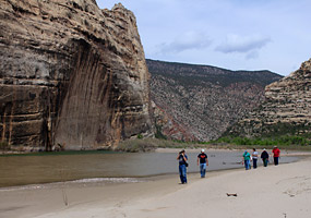 Hikers walk along the beach near the confluence of the Green and Yampa Rivers.