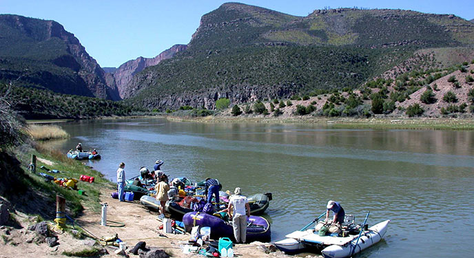 A group prepares to start their river trip at the Gates of Lodore boat ramp.