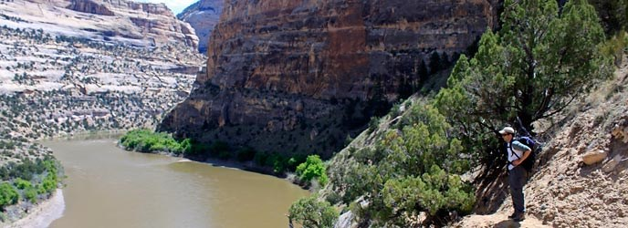 A hiker enjoys the view over the Yampa River near Jenny Lind Rock.