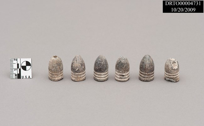 Six conical shaped Minié bullets used in the 19th century
