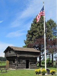 Log fort with American flag.