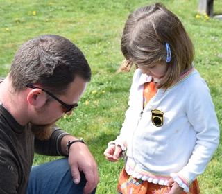 Father helps his daughter pin on an Ebey's Jr Ranger Badge