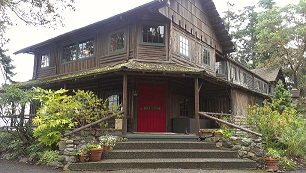 Old log inn with red door.