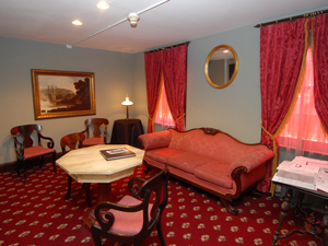 Reading Room at the Edgar Allan Poe site, complete with red sofa, carpet and drapes.