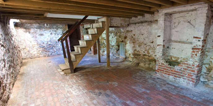 Basement of Edgar Allan Poe House showing staircase and false chimney.