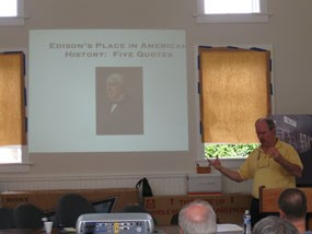 Professor Bernie Carlson speak with a group of volunteers about Thomas Edison.