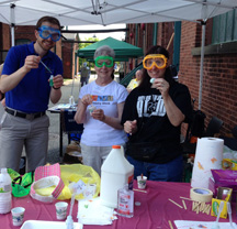 Chemists in colorful goggles ready to do an experiment with kids.