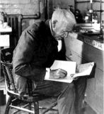 Thomas Edison taking notes in his chemistry lab.
