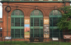 Front of Laboratory Building 5. Two banners celebrating the National Park Service hang on the brick facade.