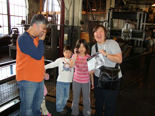 The Terrell family in the machine shop learning about Thomas Edison and working on the Junior Ranger booklet.