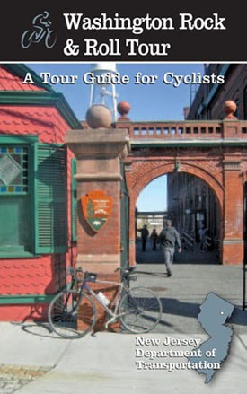 Brochure cover for bike tour with a bike leaning on a brick and concrete pillar at the park entrance.