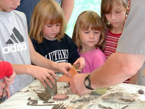 Kids at archeology day demonstration