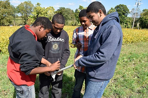 Students extract soil samples from the President's cropland for testing.