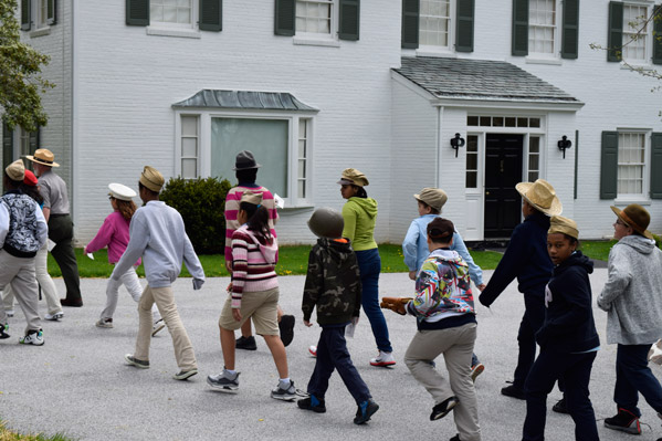 City of York students marching past President Eisenhower's home.