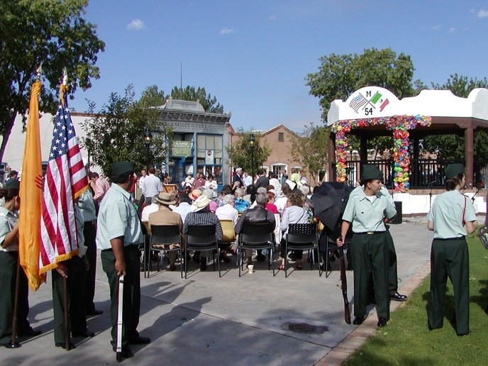 Mesilla Plaza, New Mexico, dedication with American flag and troops