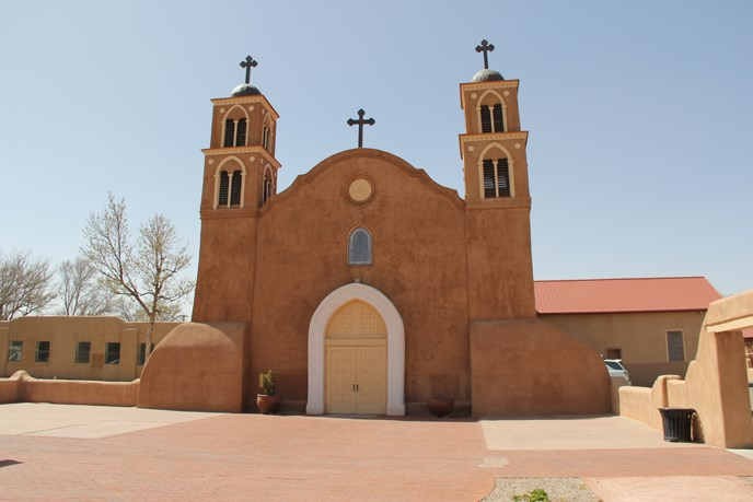 Old San Miguel Church - a mission church, adobe, with large arched doorway and two steeples with two crosses